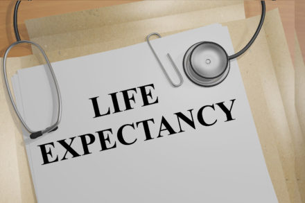 "3D illustration of ""LIFE EXPECTANCY"" title on medical documents. Medical concept."