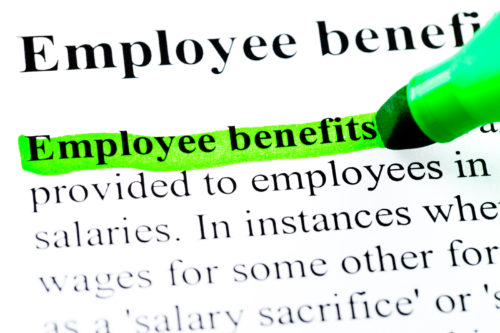 Employee benefits definition highlighted by green marker on whit