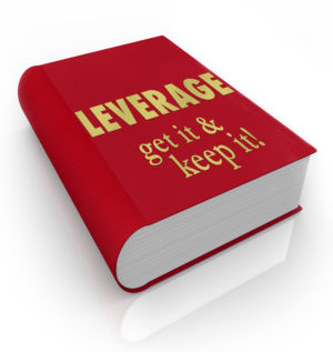 The words Leverage - Get It, Keep It on a red book cover to illu