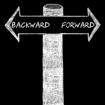 Opposite arrows with Backward versus Forward. Hand drawing with chalk on blackboard. Choice conceptual image