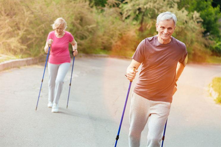 older-couple-hiking-sticks